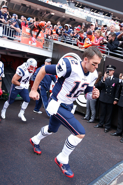 Tom Brady of the New England Patriots runs onto the field before the game against the Cleveland Browns at FirstEnergy Stadium on October 9 2016 in...