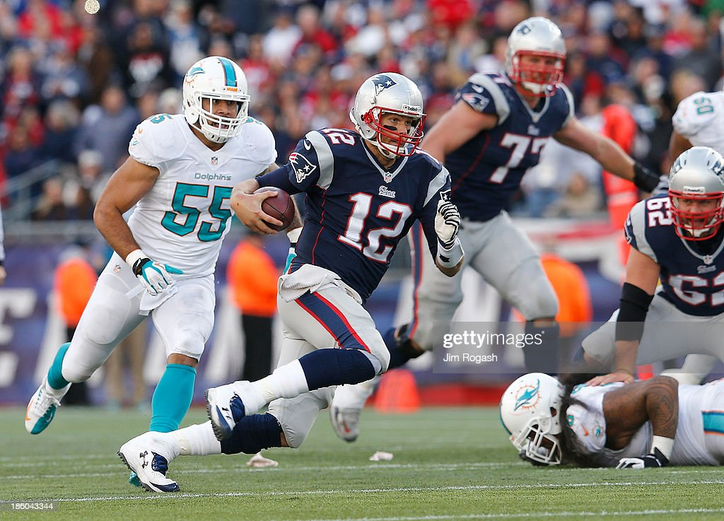 <a gi-track='captionPersonalityLinkClicked' href=/galleries/search?phrase=Tom+Brady+-+American+Football+Quarterback&family=editorial&specificpeople=201737 ng-click='$event.stopPropagation()'>Tom Brady</a> #12 of the New England Patriots runs the ball against the Miami Dolphins in the second half at Gillette Stadium on October 27, 2013 in Foxboro, Massachusetts.