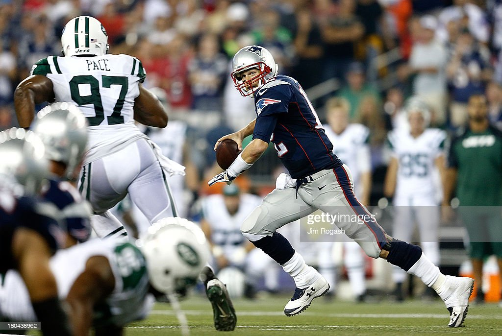 <a gi-track='captionPersonalityLinkClicked' href=/galleries/search?phrase=Tom+Brady+-+American+Football+Quarterback&family=editorial&specificpeople=201737 ng-click='$event.stopPropagation()'>Tom Brady</a> #12 of the New England Patriots scrambles against the New York Jets at Gillette Stadium in the second half on September 12, 2013 in Foxboro, Massachusetts.