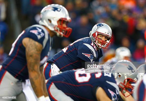 Tom Brady of the New England Patriots sets at the line of scrimmage during the first quarter against the Denver Broncos at Gillette Stadium on...