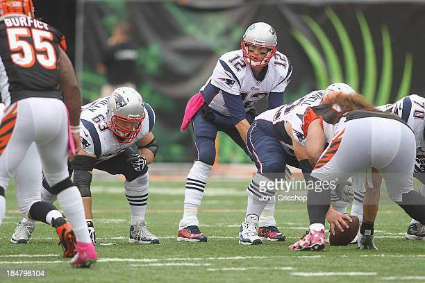 Tom Brady of the New England Patriots sets up under center at the line of scrimmage during the game against the Cincinnati Bengals at Paul Brown...