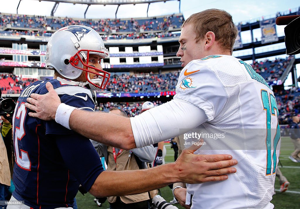 <a gi-track='captionPersonalityLinkClicked' href=/galleries/search?phrase=Tom+Brady+-+American+Football+Quarterback&family=editorial&specificpeople=201737 ng-click='$event.stopPropagation()'>Tom Brady</a> #12 of the New England Patriots shakes hands with <a gi-track='captionPersonalityLinkClicked' href=/galleries/search?phrase=Ryan+Tannehill&family=editorial&specificpeople=5573174 ng-click='$event.stopPropagation()'>Ryan Tannehill</a> #17 of the Miami Dolphins after their game at Gillette Stadium on October 27, 2013 in Foxboro, Massachusetts.
