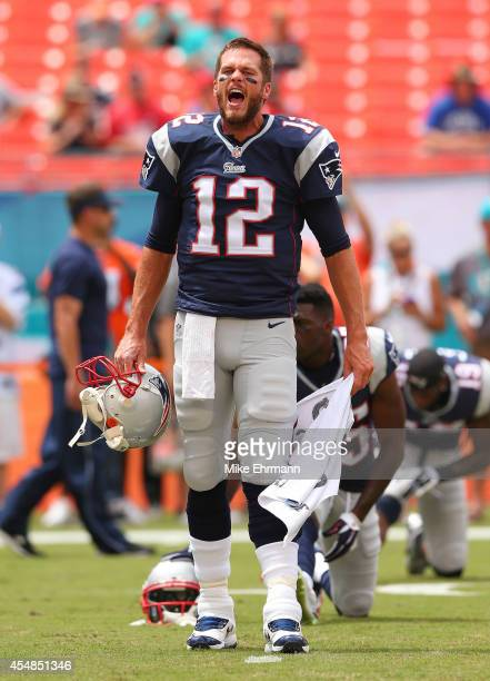 Tom Brady of the New England Patriots shouts encouragement to teammates during pregame workouts before his team met the Miami Dolphins at Sun Life...