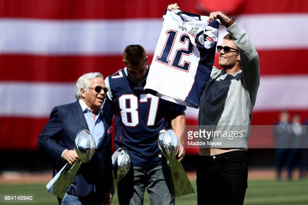 Tom Brady of the New England Patriots shows off his Super Bowl LI jersey before the opening day game between the Boston Red Sox and the Pittsburgh...