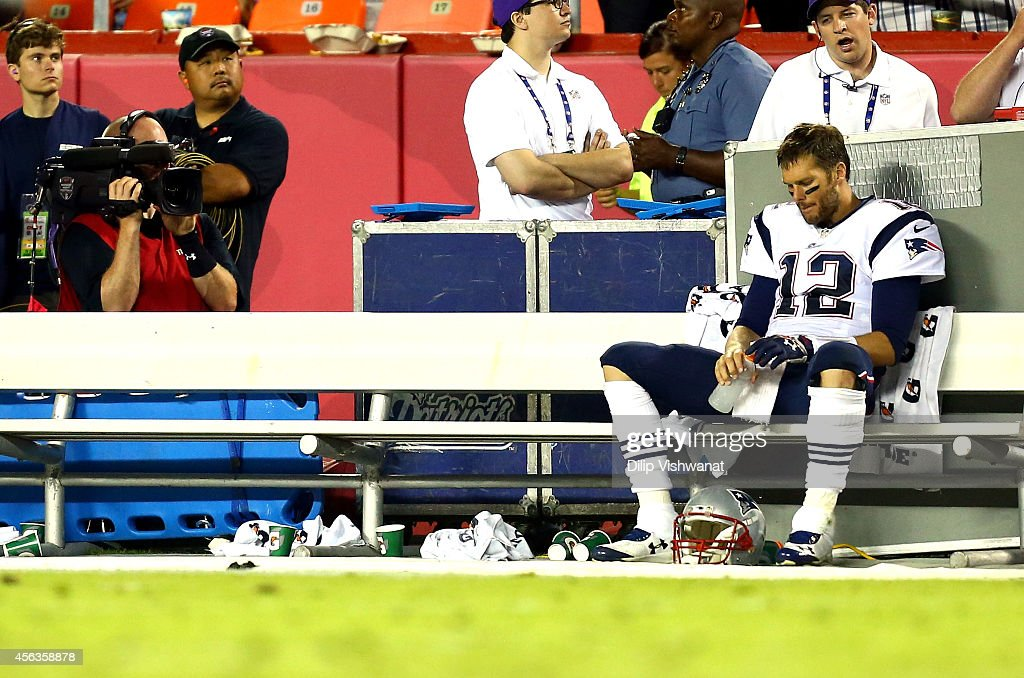 Tom Brady of the New England Patriots sits on the sidelines late in the fourth quarter during the game against the Kansas City Chiefs at Arrowhead...