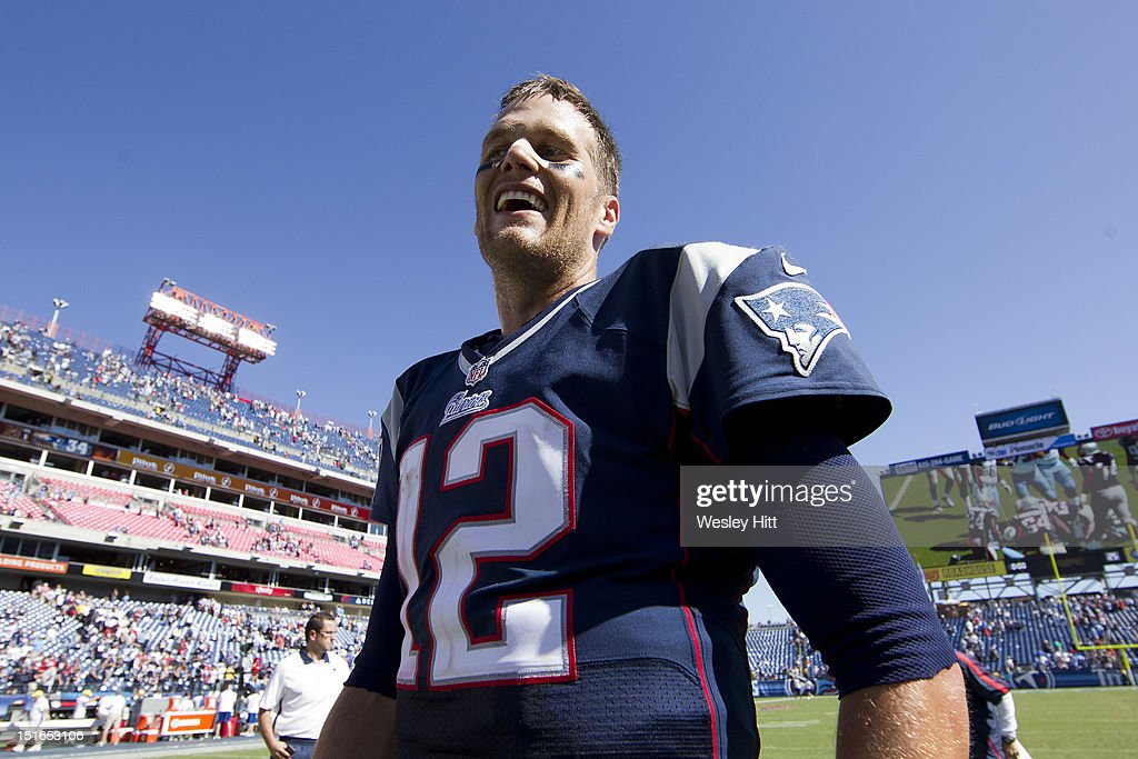 <a gi-track='captionPersonalityLinkClicked' href=/galleries/search?phrase=Tom+Brady+-+American+Football+Quarterback&family=editorial&specificpeople=201737 ng-click='$event.stopPropagation()'>Tom Brady</a> #12 of the New England Patriots smiles while walking off the field after the season opener against the Tennessee Titans at LP Field on September 8, 2012 in Nashville, Tennessee. The Patriots defeated the Titans 34 to 13.