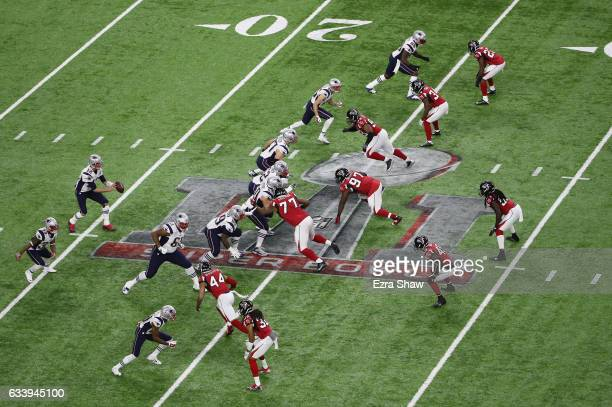 Tom Brady of the New England Patriots takes the snap in the first quarter against the Atlanta Falcons during Super Bowl 51 at NRG Stadium on February...