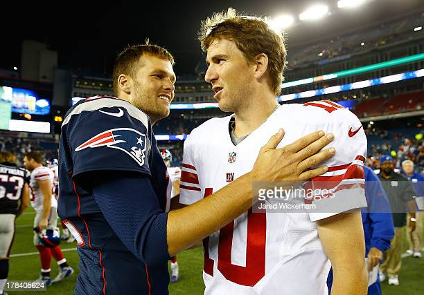 Tom Brady of the New England Patriots talks to Eli Manning of the New York Giants following their preseason game at Gillette Stadium on August 29...