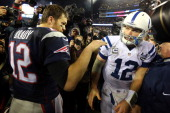 Tom Brady of the New England Patriots talks with Andrew Luck of the Indianapolis Colts after their AFC Divisional Playoff game at Gillette Stadium on...