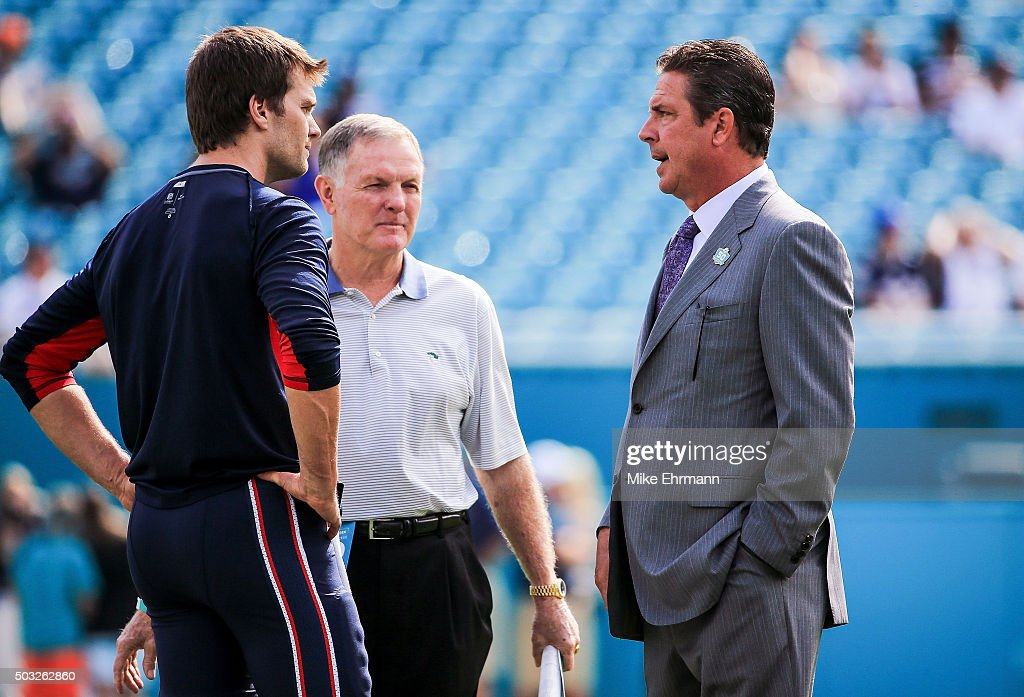 <a gi-track='captionPersonalityLinkClicked' href=/galleries/search?phrase=Tom+Brady+-+American+Football+Quarterback&family=editorial&specificpeople=201737 ng-click='$event.stopPropagation()'>Tom Brady</a> #12 of the New England Patriots talks with former Miami Dolphins quarterbacks <a gi-track='captionPersonalityLinkClicked' href=/galleries/search?phrase=Bob+Griese&family=editorial&specificpeople=228017 ng-click='$event.stopPropagation()'>Bob Griese</a> (center) and <a gi-track='captionPersonalityLinkClicked' href=/galleries/search?phrase=Dan+Marino&family=editorial&specificpeople=203298 ng-click='$event.stopPropagation()'>Dan Marino</a> (right) on the field before the game against the Miami Dolphins at Sun Life Stadium on January 3, 2016 in Miami Gardens, Florida.
