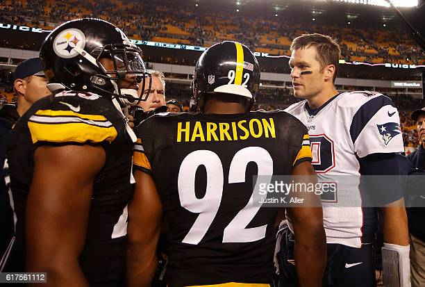 Tom Brady of the New England Patriots talks with James Harrison and Mike Mitchell of the Pittsburgh Steelers after the conclusion of the New England...