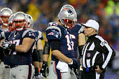 Tom Brady of the New England Patriots talks with referee Walt Anderson during the 2015 AFC Championship Game against the Indianapolis Colts at...