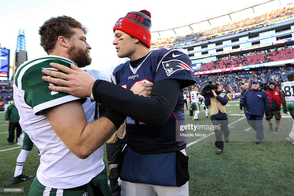 Tom Brady #12 of the New England Patriots talks with Ryan Fitzpatrick #14 of the New York Jets after the Patriots defeat the Jets 41-3 at Gillette Stadium on December 24, 2016 in Foxboro, Massachusetts.