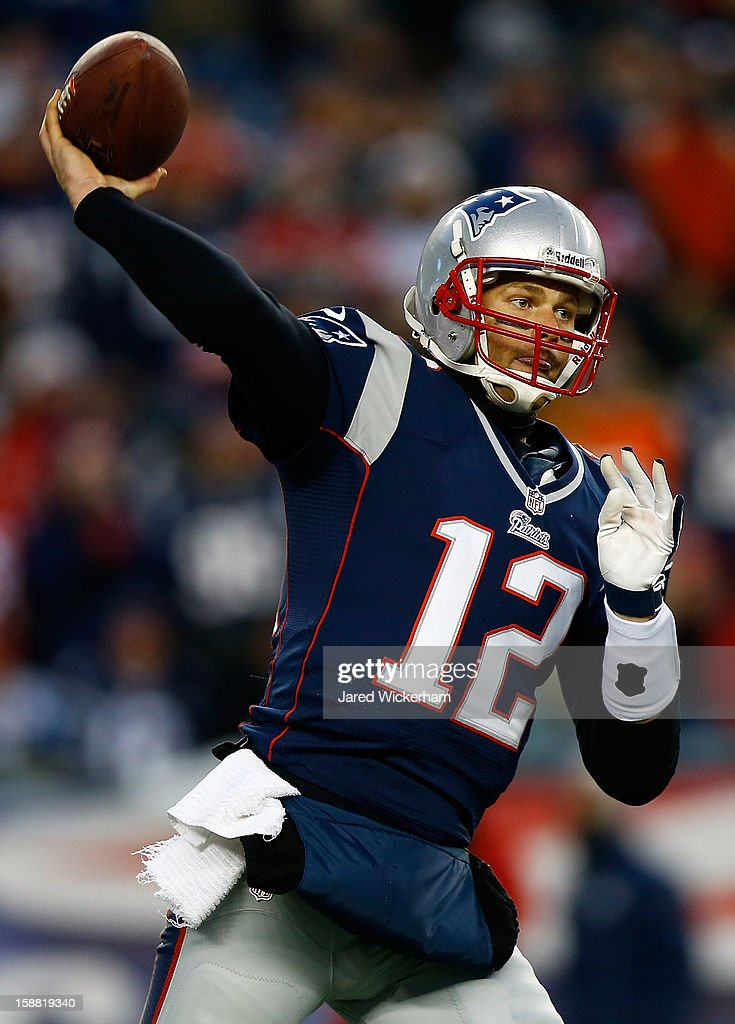 Tom Brady #12 of the New England Patriots throws a pass against the Miami Dolphins during the game at Gillette Stadium on December 30, 2012 in Foxboro, Massachusetts.