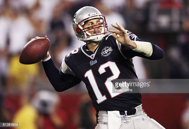 Tom Brady of the New England Patriots throws a pass against the Indianapolis Colts during the NFL game at Gillette Stadium on September 9 2004 in...