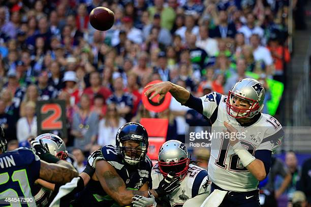 Tom Brady of the New England Patriots throws a pass in the first quarter against the Seattle Seahawks during Super Bowl XLIX at University of Phoenix...