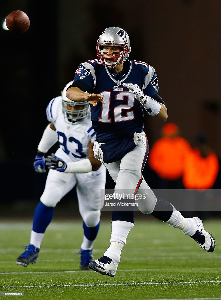 <a gi-track='captionPersonalityLinkClicked' href=/galleries/search?phrase=Tom+Brady+-+American+Football+Quarterback&family=editorial&specificpeople=201737 ng-click='$event.stopPropagation()'>Tom Brady</a> #12 of the New England Patriots throws a pass while on the run against the Indianapolis Colts during the game on November 18, 2012 at Gillette Stadium in Foxboro, Massachusetts.