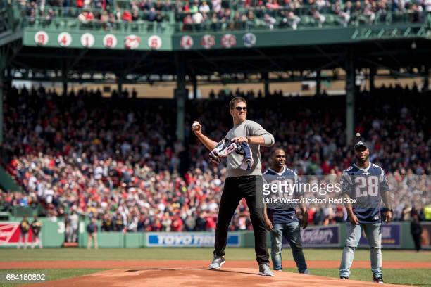 Tom Brady of the New England Patriots throws out the ceremonial first pitch during a pregame ceremony before the Boston Red Sox home opener against...