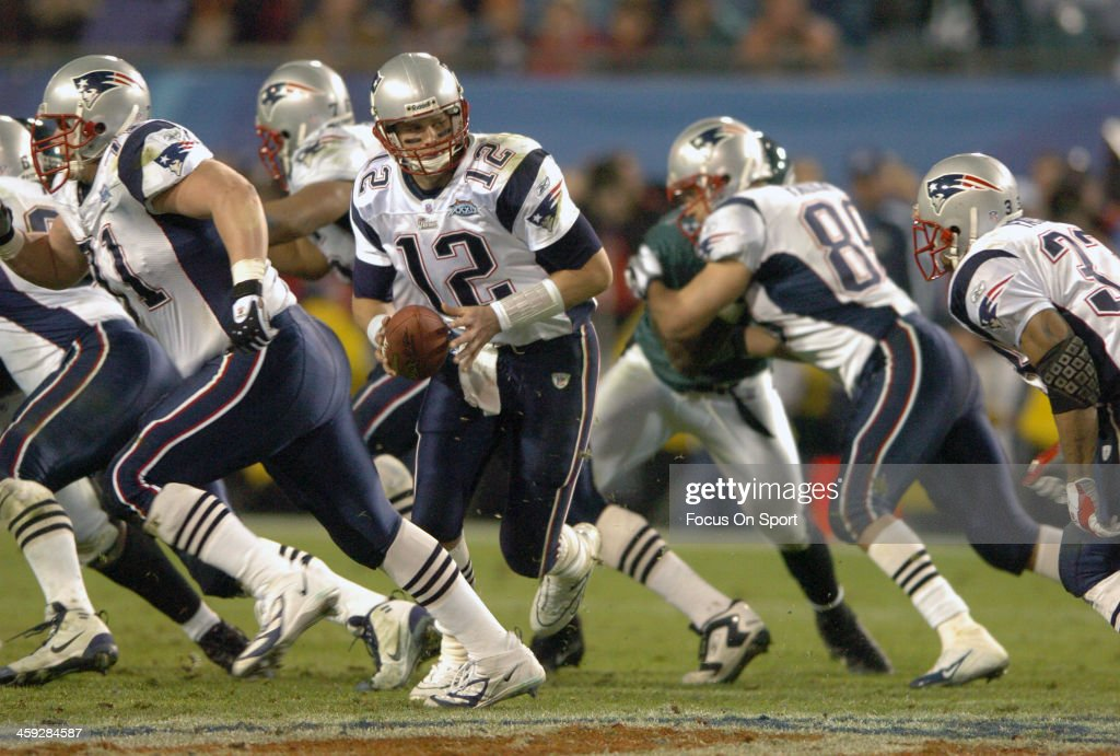 Tom Brady #12 of the New England Patriots turns to hand the ball off against the Philadelphia Eagles during Super Bowl XXXIX at Alltel Stadium on February 6, 2005 in Jacksonville, Florida. The Patriots won the game 24-21.