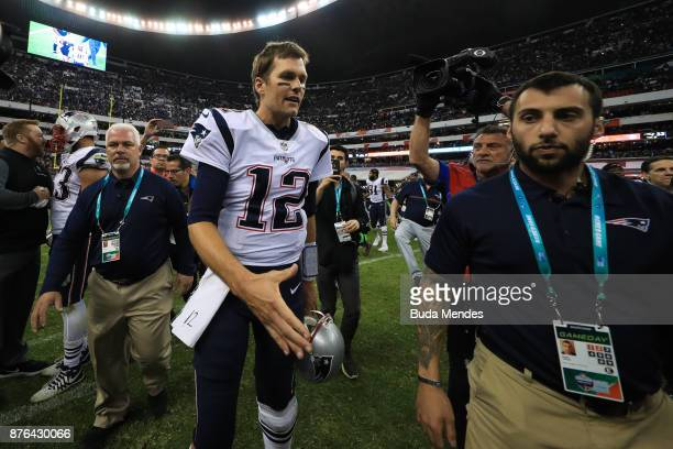 Tom Brady of the New England Patriots walks off the field after defeating the Oakland Raiders at Estadio Azteca on November 19 2017 in Mexico City...