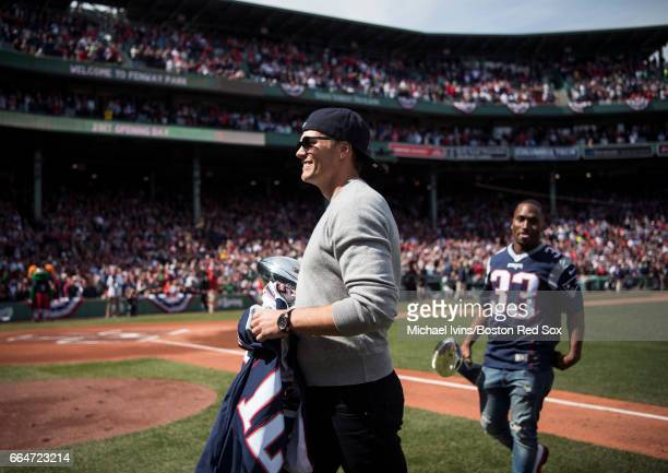 Tom Brady of the New England Patriots walks off the field following a ceremony honoring the Super Bowl champions at Fenway Park before an opening gay...