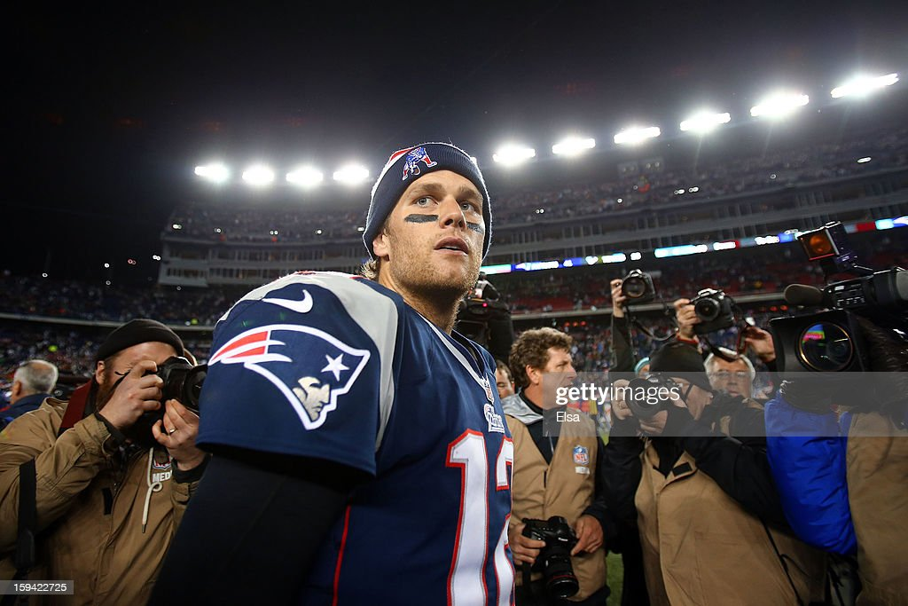 Tom Brady #12 of the New England Patriots walks on the field after defeating the Houston Texans by a score of 41-28 to win the 2013 AFC Divisional Playoffs game at Gillette Stadium on January 13, 2013 in Foxboro, Massachusetts.