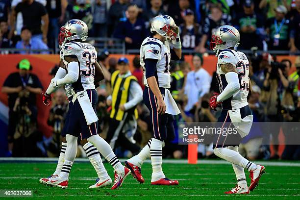 Tom Brady of the New England Patriots walks to the sideline after an interception in the first quarter against the Seattle Seahawks during Super Bowl...