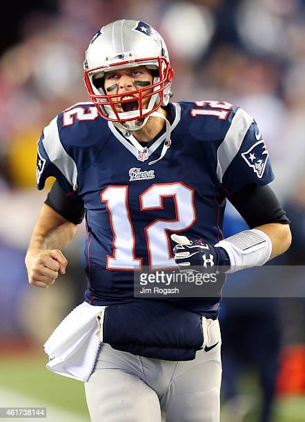 Tom Brady of the New England Patriots warms up before the 2015 AFC Championship Game against the Indianapolis Colts at Gillette Stadium on January 18...