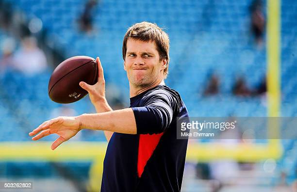 Tom Brady of the New England Patriots warms up before the game against the Miami Dolphins at Sun Life Stadium on January 3 2016 in Miami Gardens...
