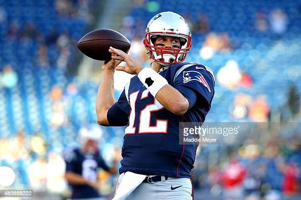 Tom Brady of the New England Patriots warms up prior to a preseason game against the Green Bay Packers at Gillette Stadium on August 13 2015 in...