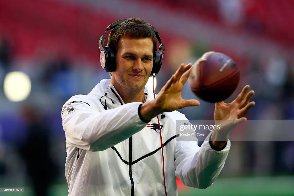 <a gi-track='captionPersonalityLinkClicked' href=/galleries/search?phrase=Tom+Brady+-+American+football-quarterback&family=editorial&specificpeople=201737 ng-click='$event.stopPropagation()'>Tom Brady</a> #12 of the New England Patriots warms up prior to Super Bowl XLIX against the Seattle Seahawks at University of Phoenix Stadium on February 1, 2015 in Glendale, Arizona.