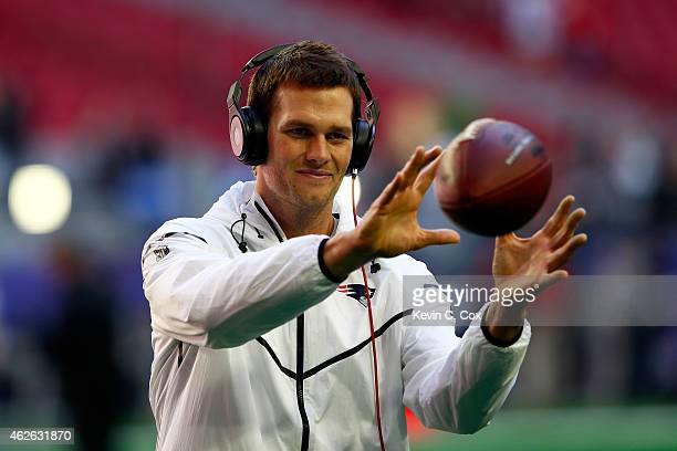 Tom Brady of the New England Patriots warms up prior to Super Bowl XLIX against the Seattle Seahawks at University of Phoenix Stadium on February 1...
