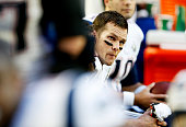 Tom Brady of the New England Patriots watches from the sidelines as his team plays the Seattle Seahawks in the second quarter during Super Bowl XLIX...
