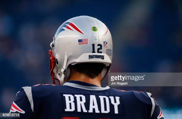 Tom Brady of the New England Patriots watches the pregame action before a preseason game with Jacksonville Jaguars at Gillette Stadium on August 10...