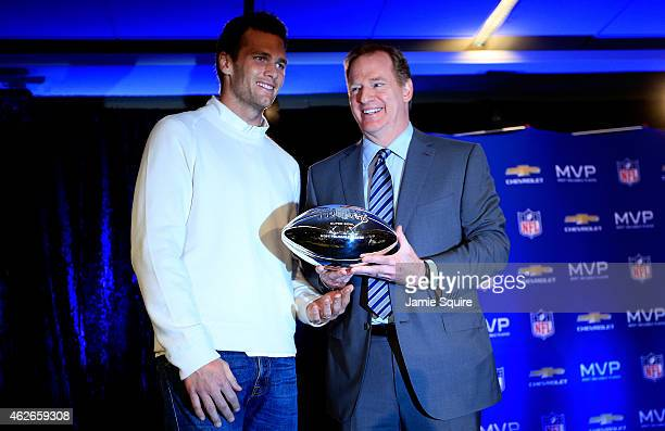 Tom Brady of the New England Patriots with NFL Commissioner Roger Goodell and the Super Bowl XLIX MVP trophy during a press conference folowing the...