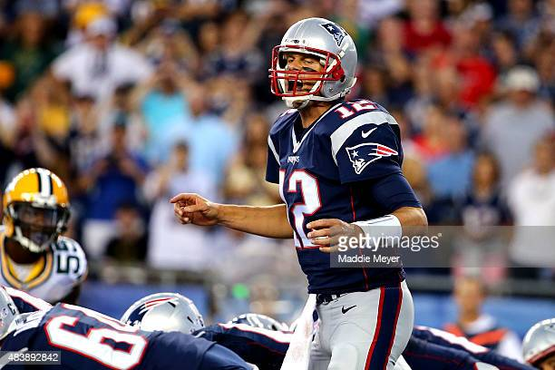 Tom Brady of the New England Patriots yells at the line of scrimmage in the first quarter against the Green Bay Packers during a preseason game at...