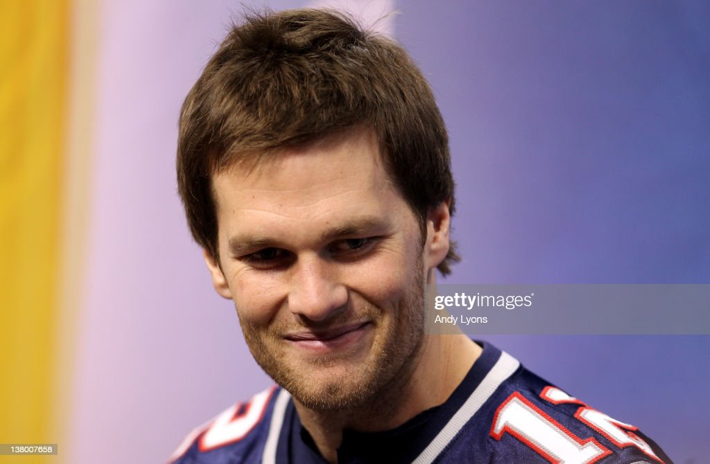 Tom Brady #12 of the New England Patriotsanswers questions from the media during Media Day ahead of Super Bowl XLVI between against the New York Giants at Lucas Oil Stadium on January 31, 2012 in Indianapolis, Indiana.