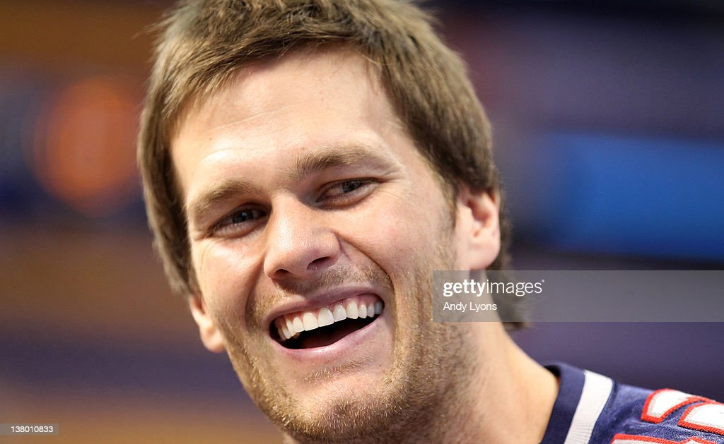 Tom Brady #12 of the New England Patriotsanswers questions from the media during Media Day ahead of Super Bowl XLVI against the New York Giants at Lucas Oil Stadium on January 31, 2012 in Indianapolis, Indiana.