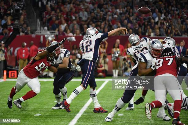 Tom Brady of the Patriots passes during Super Bowl LI between the New England Patriots and the Atlanta Falcons at NGR Stadium in Houston Texas on...