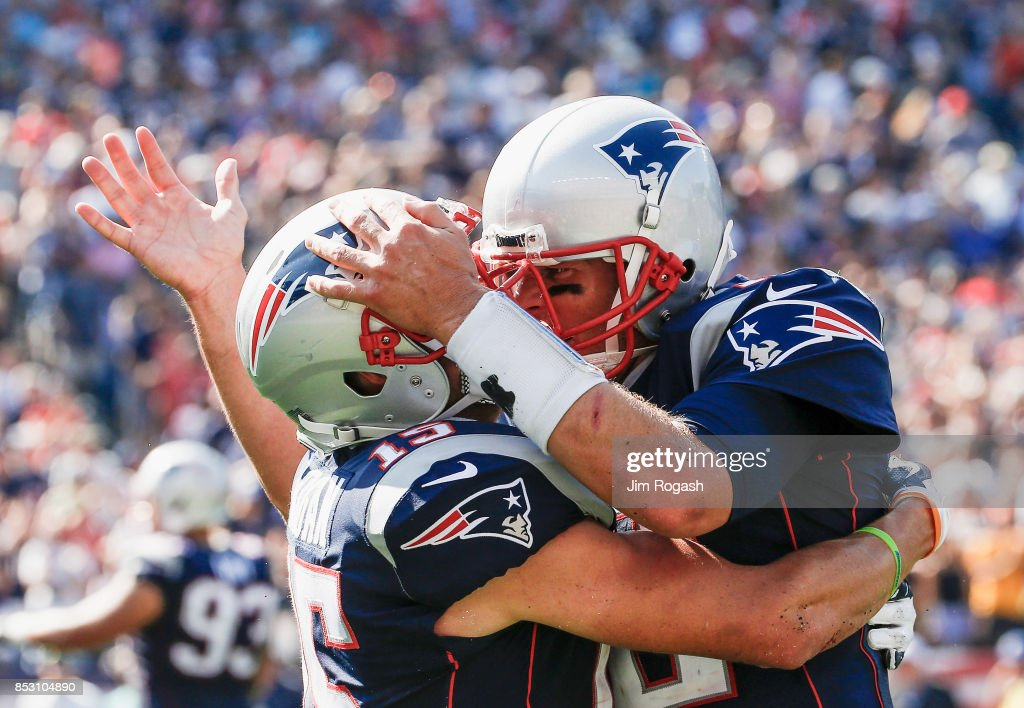 Tom Brady #12 reacts with Chris Hogan #15 of the New England Patriots after a touchdown during the second quarter of a game against the Houston Texans at Gillette Stadium on September 24, 2017 in Foxboro, Massachusetts.