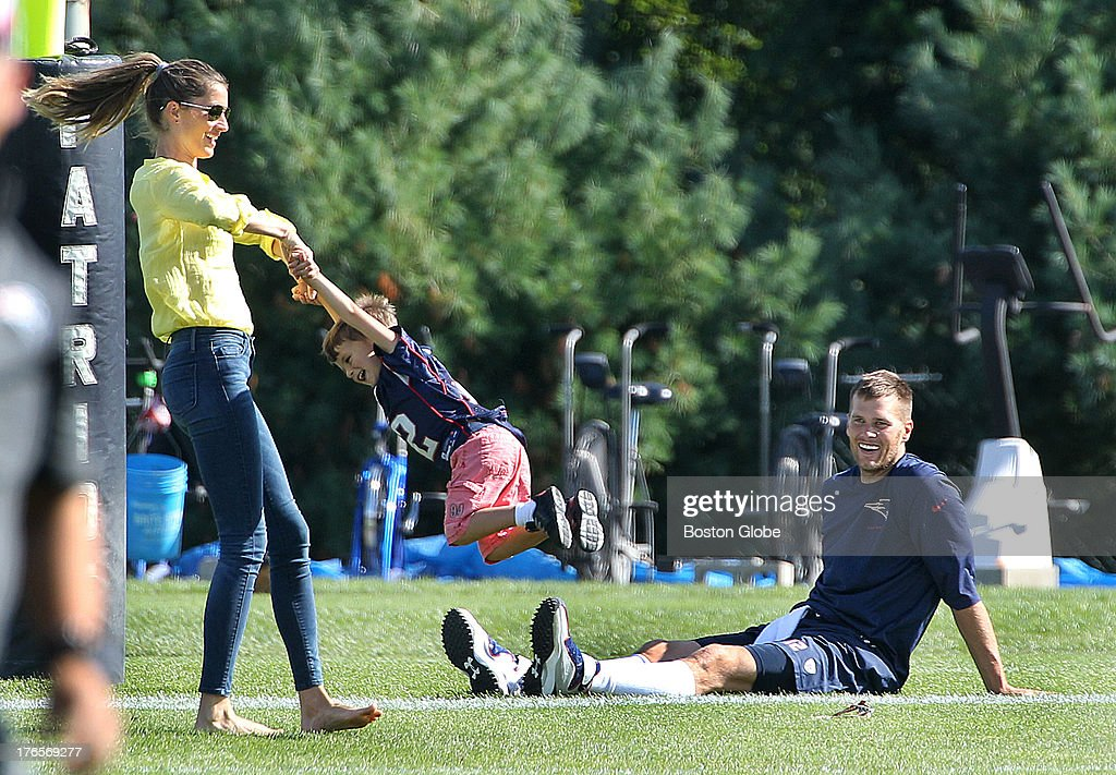 <a gi-track='captionPersonalityLinkClicked' href=/galleries/search?phrase=Tom+Brady+-+American+Football+Quarterback&family=editorial&specificpeople=201737 ng-click='$event.stopPropagation()'>Tom Brady</a> sits while his wife Gisele Bundhen spins their son, Benjamin, as the New England Patriots end their last practice, on Thursday, August 15, 2013, before the Friday exhibition game against the Tampa Bay Buccaneers.