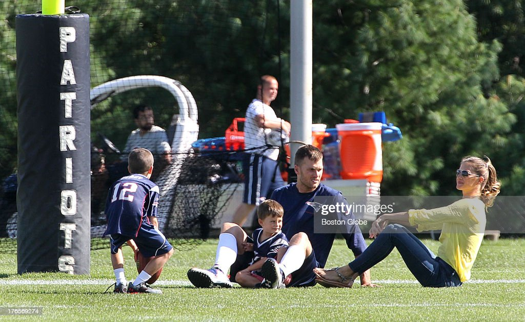 <a gi-track='captionPersonalityLinkClicked' href=/galleries/search?phrase=Tom+Brady+-+American+Football+Quarterback&family=editorial&specificpeople=201737 ng-click='$event.stopPropagation()'>Tom Brady</a> sits with wife Gisele Bundhen and their sons, Benjamin, center, and Jack as the New England Patriots end their last practice on Thursday, August 15, 2013, before the Friday exhibition game against the Tampa Bay Buccaneers.