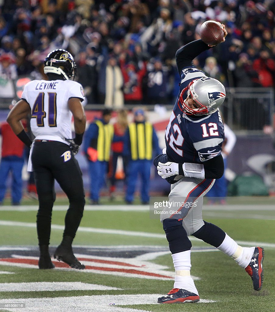 Tom Brady spikes the ball after rushing for a touchdown in the first quarter of the AFC Divisional Playoff Game between the New England Patriots and...