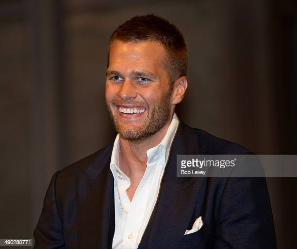 Tom Brady takes questions from guests during a benefit for Best Buddies International an international organization that helps people with...