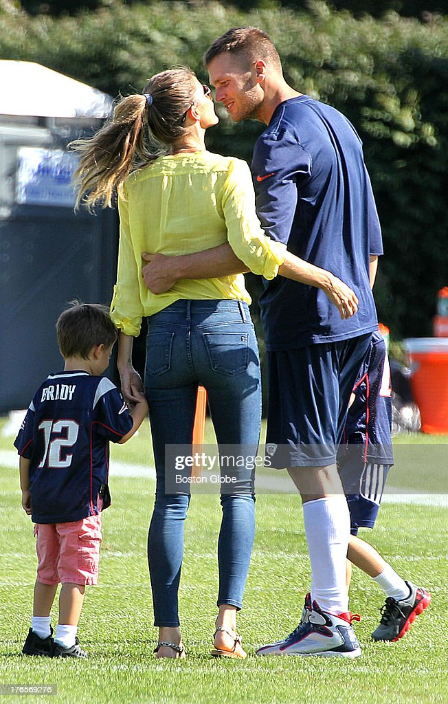 Tom Brady walks with his wife, Gisele Bundchen, and their sons, Benjamin, left, and Jack, partially hidden, as the New England Patriots end their last practice on Thursday, August 15, 2013, before the Friday exhibition game against the Tampa Bay Buccaneers.