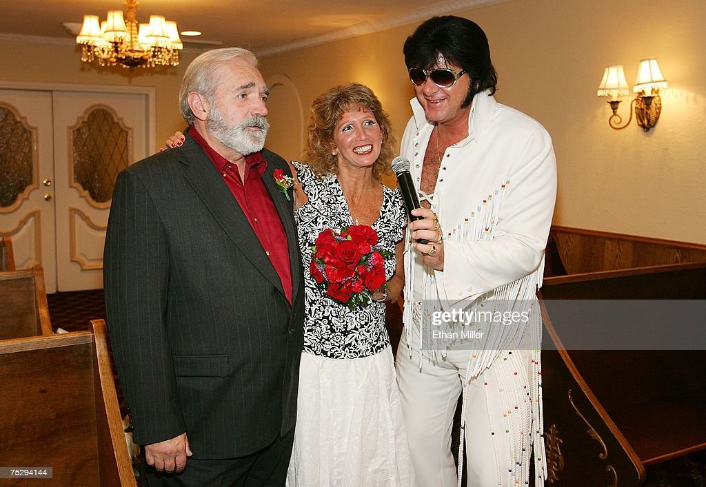 Tom Brewington (L) and his wife Mickey Brewington of Arizona sing with Elvis Presley impersonator Jeff Stanulis during their wedding ceremony at the Graceland Wedding Chapel July 7, 2007 in Las Vegas, Nevada. Wedding planners say a flood of couples are marrying on 7/7/07 due to the numerical and superstitious significance of the date.
