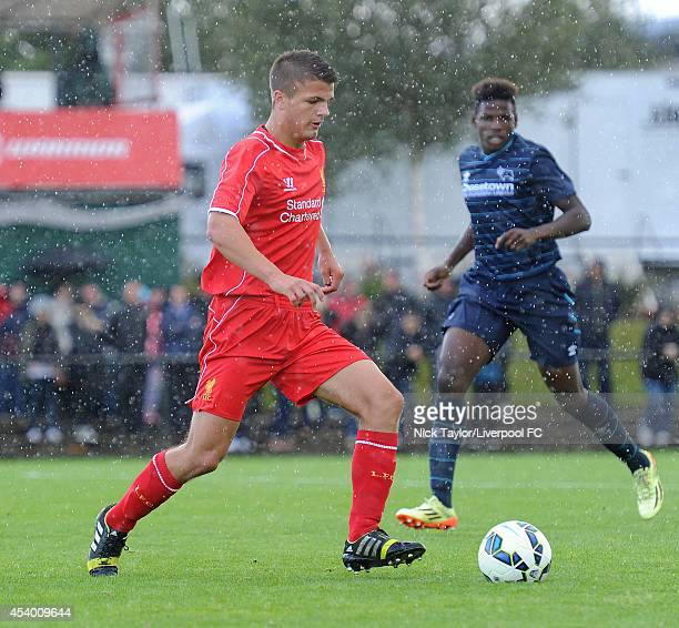 Tom Brewitt of Liverpool and Offrande Zanzala of Derby County in action during the Barclays Premier League Under 18 fixture between Liverpool and...