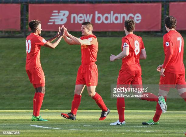 Tom Brewitt of Liverpool celebrates his goal with team mates Madger Gomes Matty Virtue and Jordan Williams during the Liverpool v Rochdale Lancashire...