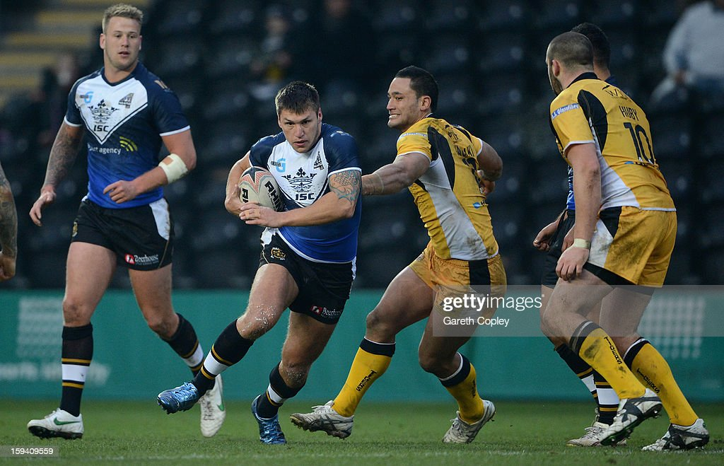 Tom Briscoe of Hull FC gets Weller Hauraki and Craig Huby of Castleford during a pre-season friendly match between Hull FC and Castleford Tigers at The KC Stadium on January 13, 2013 in Hull, England.