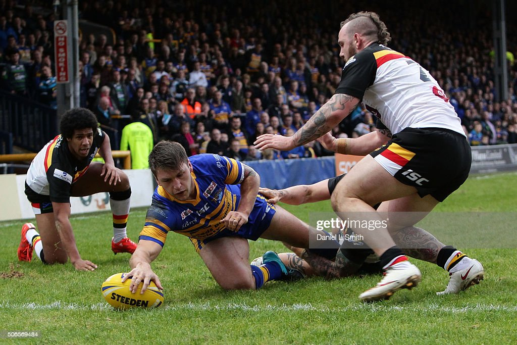 Tom Briscoe of Leeds Rhinos breaks through a tackle from Jay Pitts of Bradford Bulls and crosses over to score his side a try during the Leeds Rhinos v Bradford Bulls friendly match at Headingley Carnegie Stadium on January 24, 2016 in Leeds, England.